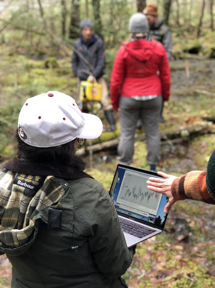 Kristy and Clara observing methane fluxes in an upland forest (Yale Myers)